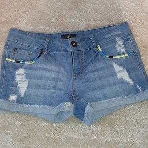 Jean shorts with rips and stitching detail